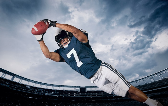 American Football Player Catching a touchdown Pass
