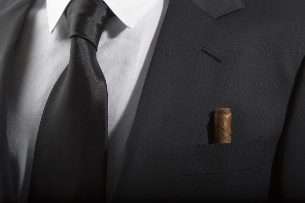 Jacket and tie with cuban cigar in the pocket, Italian fashion concept