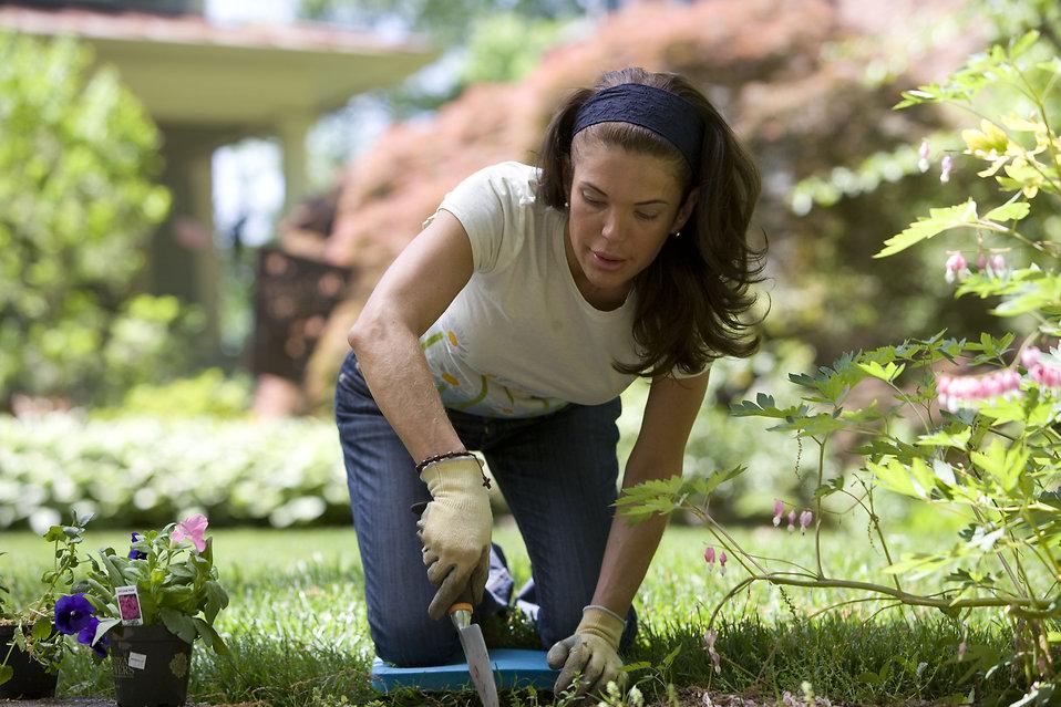 16337-a-woman-enjoying-gardening-outdoors-pv